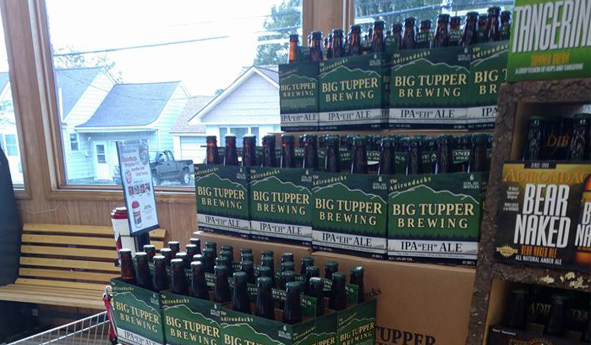 "A large inventory Big Tupper Brewing's IPA ""Eh"" Ale have been conveniently located near the checkout at Shaheen's IGA all summer."