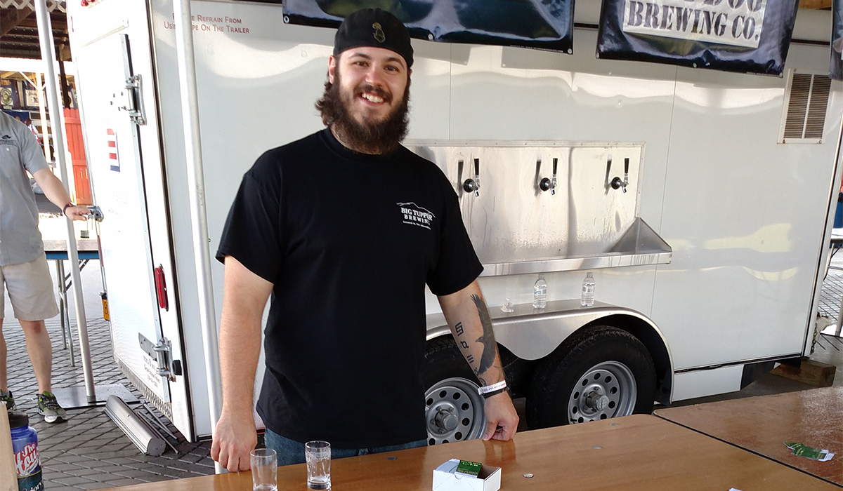 "Big Tupper Brewing's Brewer Rick LaFlamme serves of some IPA ""Eh"" Ale at the Saratoga Brewfest in June."