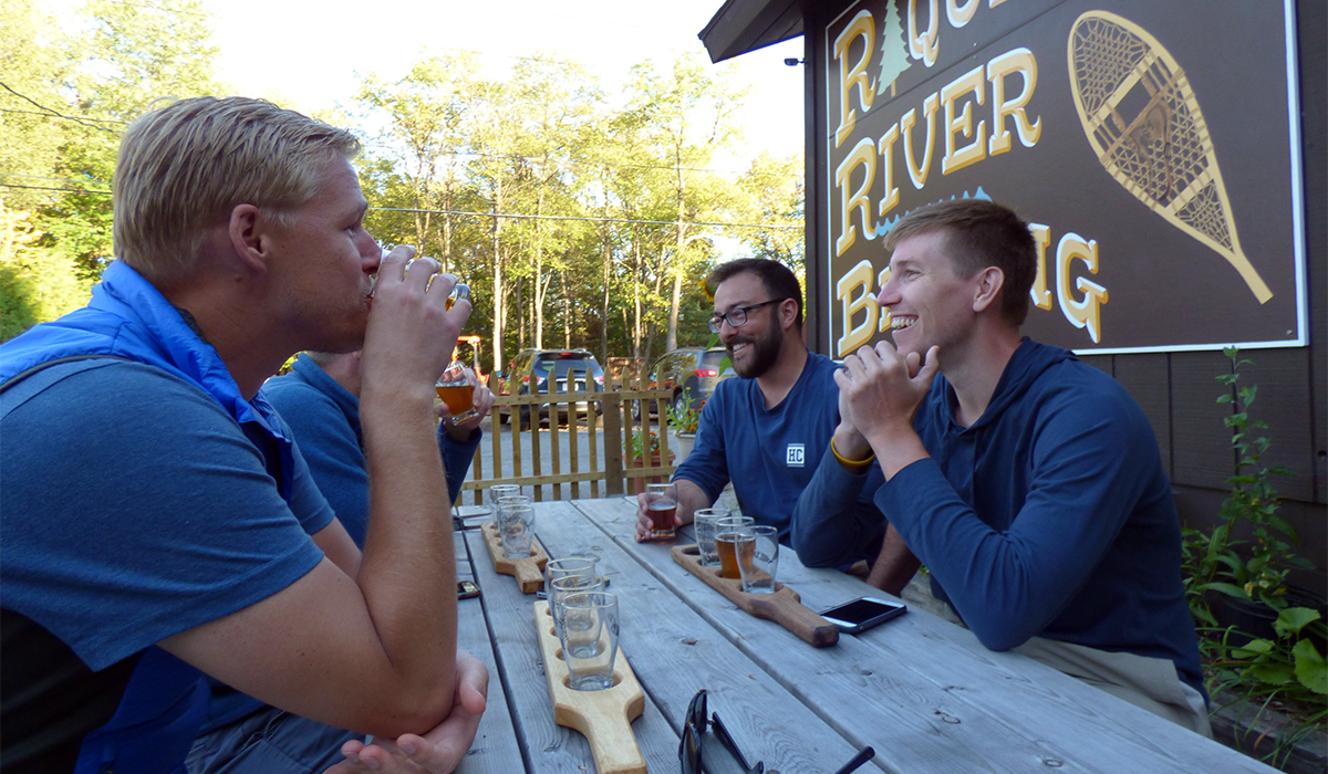 Fellow beer lovers sampling some brew at Raquette River Brewing.