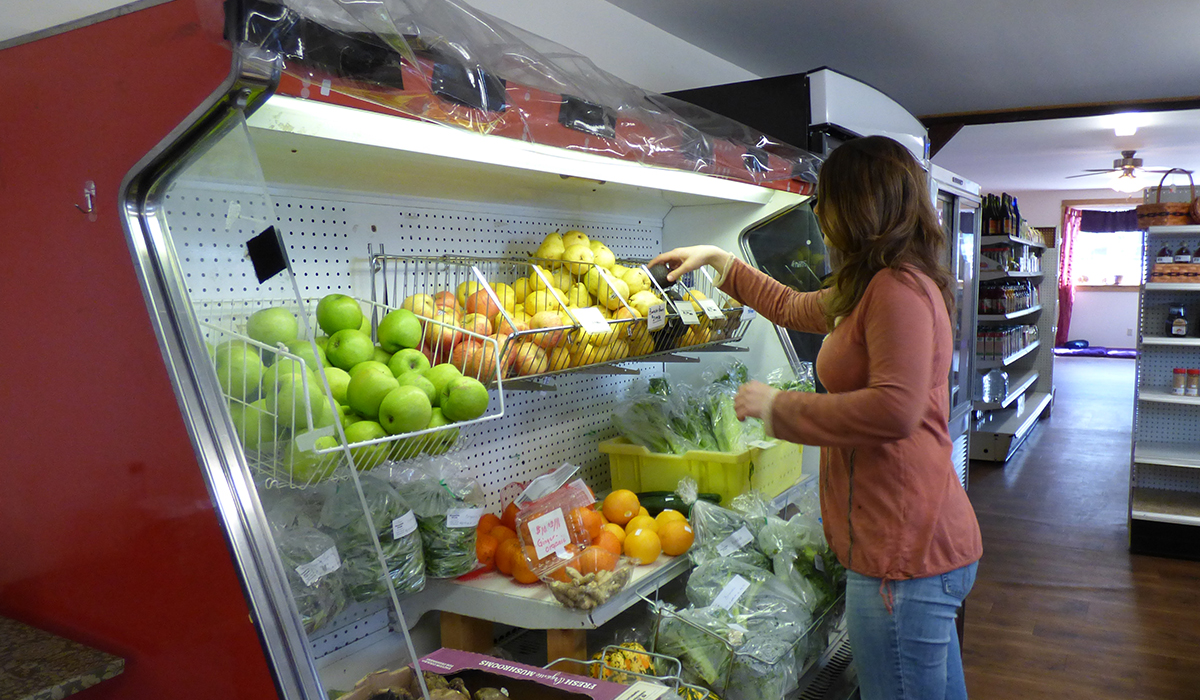 Kristen tends to the in-store produce selection at The Health Hub in Tupper Lake