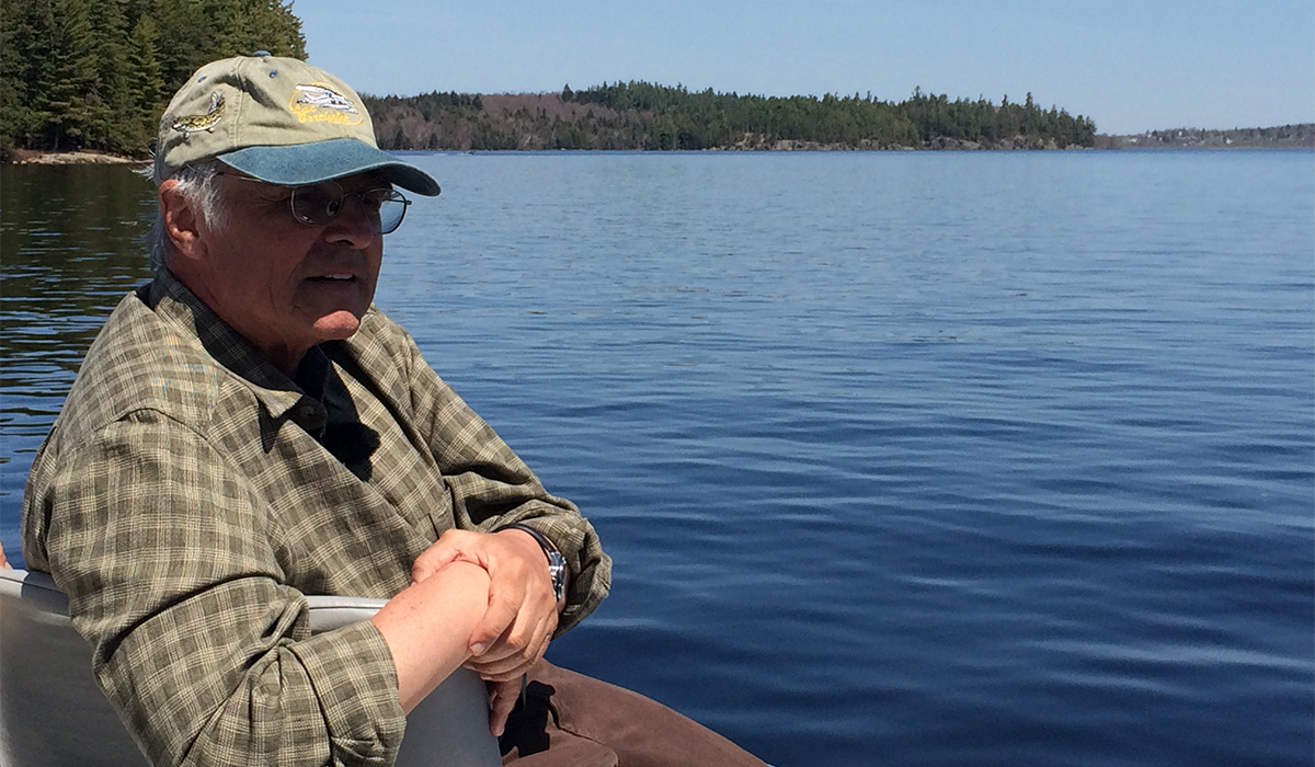 Television fishing personality, Don Meissner, enjoys the scenery from a fishing boat on Big Tupper Lake