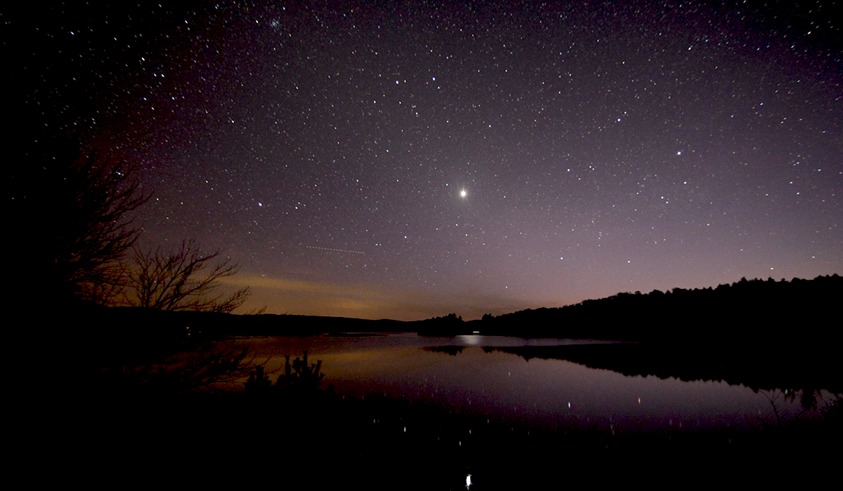 Venus reflects off Rock Island Bay in Tupper Lake, NY (Marc Staves photo)