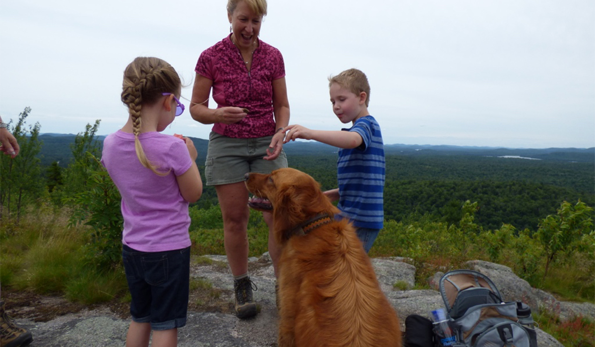 Even four-legged friends enjoy a snack and the view at the top of Coney Mountain