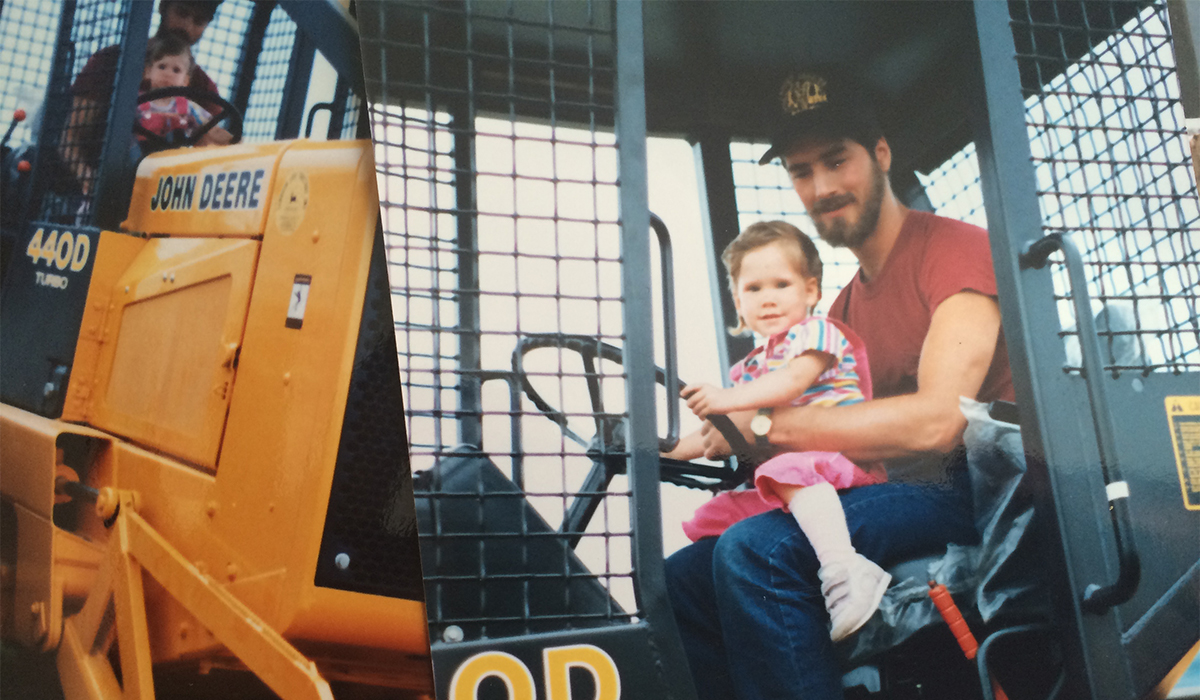 Me riding in the skidder with my dad (mid-1980's). Seriously though, what's with the knee-socks?