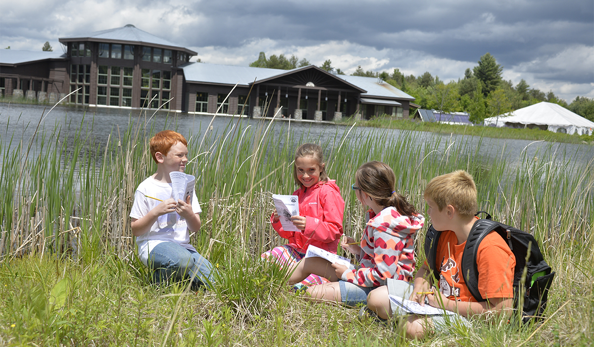 Youngsters working hard to earn their Jr. Naturalist Patch - The Wild Center photo