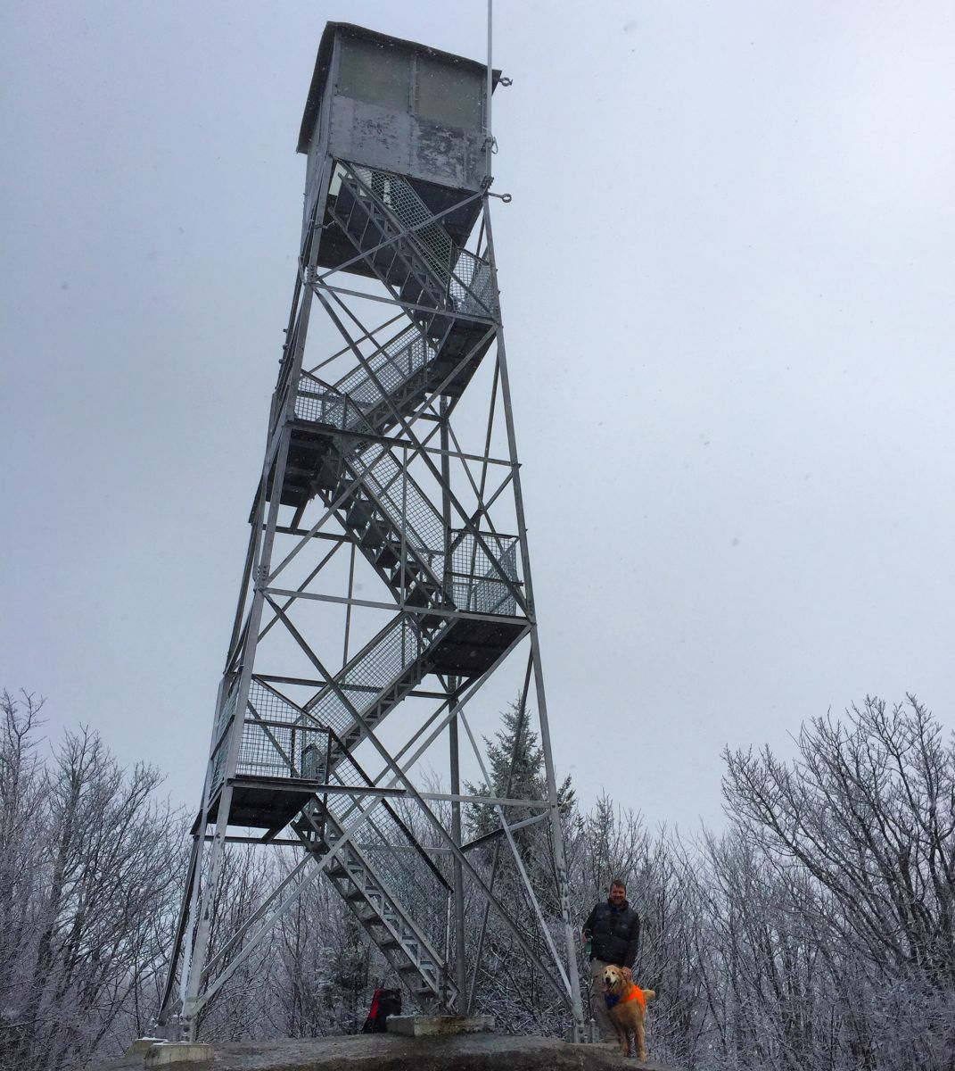 Tim and his four-legged companion, Jack, enjoy a December afternoon at the Mount Arab fire tower. Photo courtesy of Noelle Short