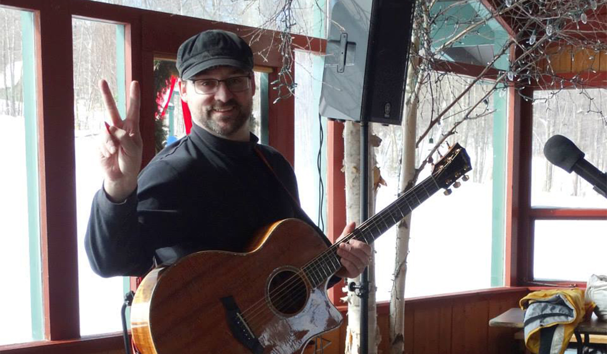 "Josh Clement rockin' in the Big Tupper Ski Lodge during the 1st Annual Tupper Lake Fire & Ice Festival. (Jim ""Cookie"" Lanthier photo)"