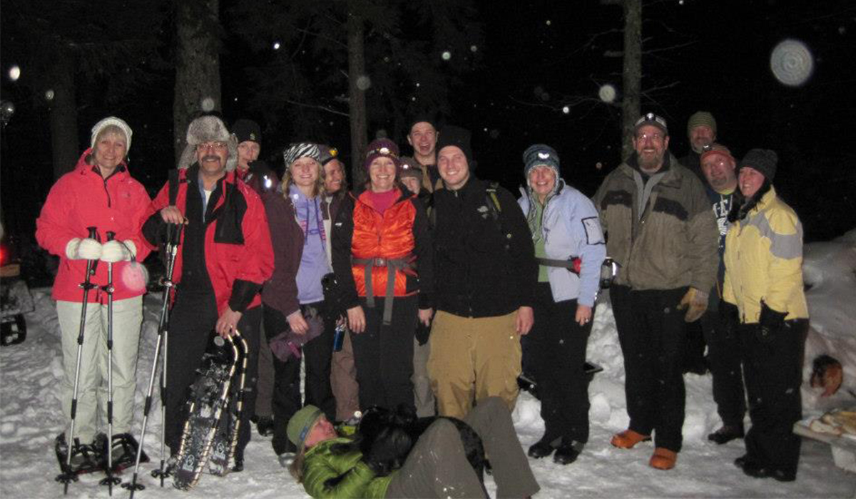Group gathers on the trails for a full moon ski & bonfire. (Tupper Lake Groomed Cross Country Ski Center photo)