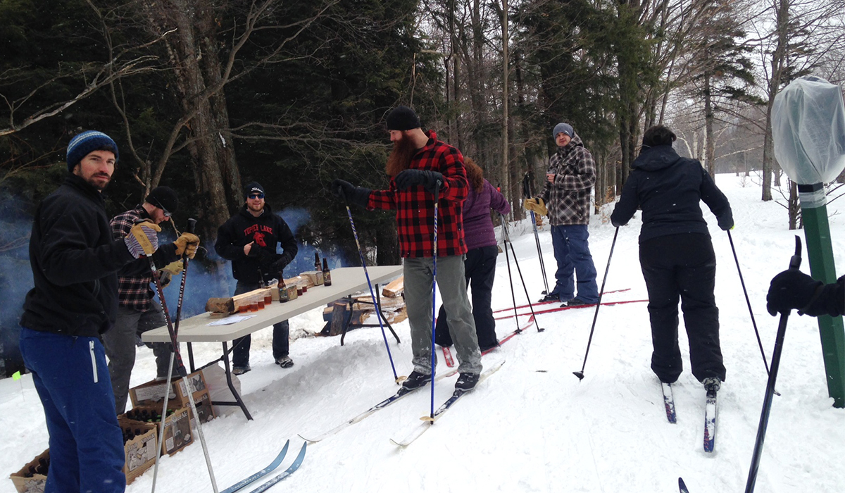 Skiers sample on the trails of the Tupper Lake Groomed Cross Country Ski Center during the 2015 Brew-Ski (ROOST/Jess Collier photo)