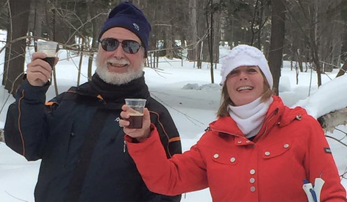 Participants enjoy sampling local brews on the trails of the Tupper Lake Cross Country Ski Center during the annual Brew-Ski.