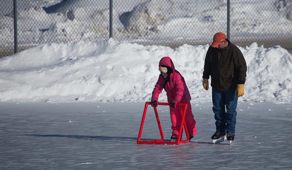 Learning to skate on the outdoor rink at the Tupper Lake Municipal Park.