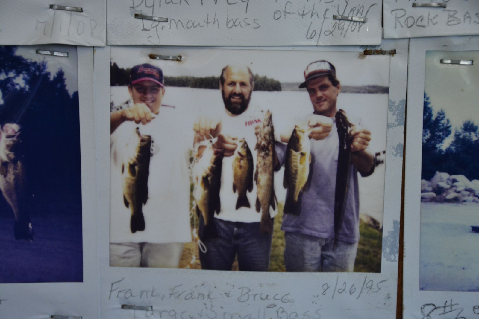 Frank Scotti, center, and his son Frank, left, and Bruce, right, showing off their catches of the day in a photo taken in 1995 that hangs on the Blue Jay Campsite store wall.