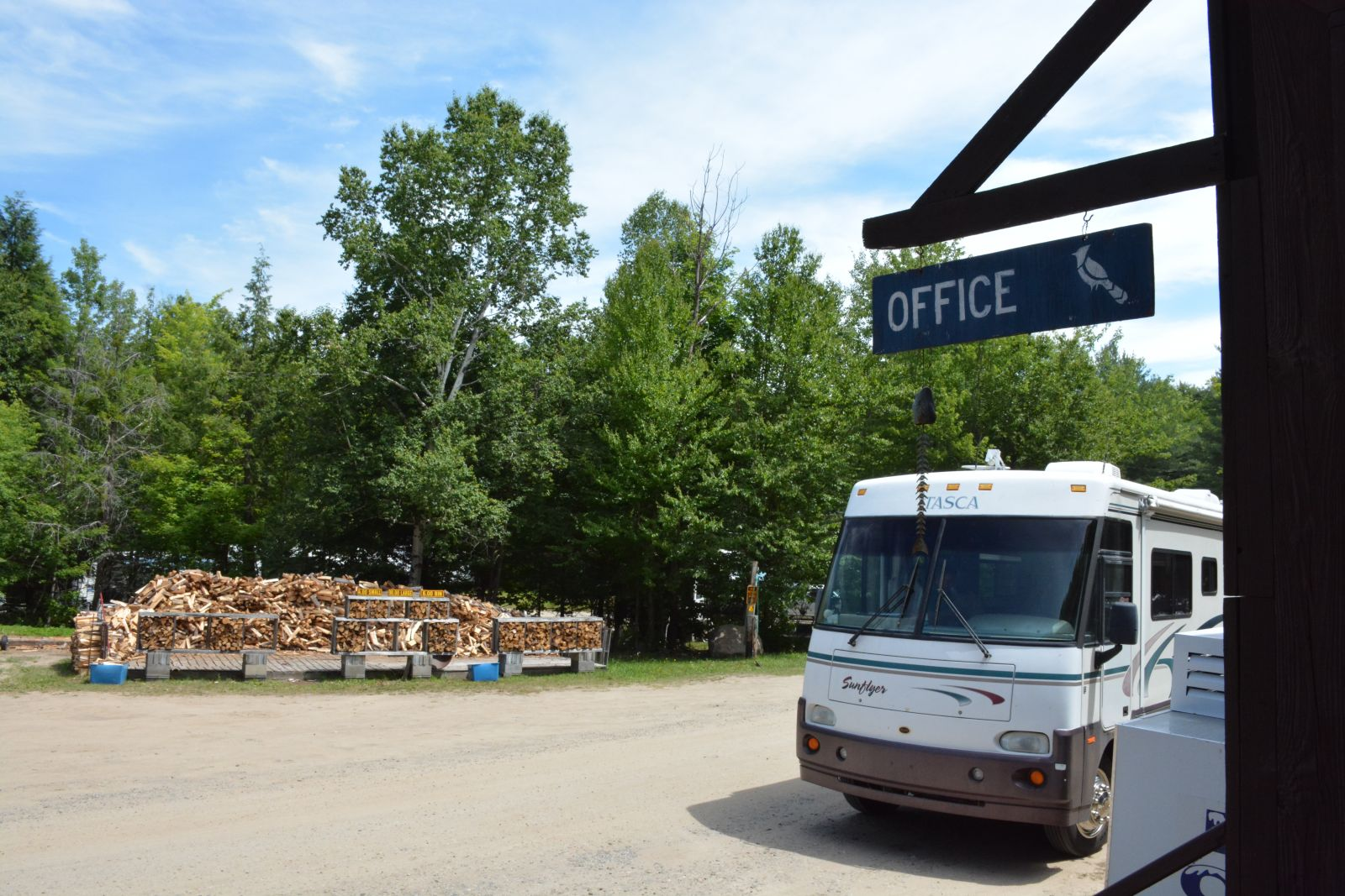 Campers stop by the Blue Jay Campsite office to check in for their stay at the Adirondack campground.