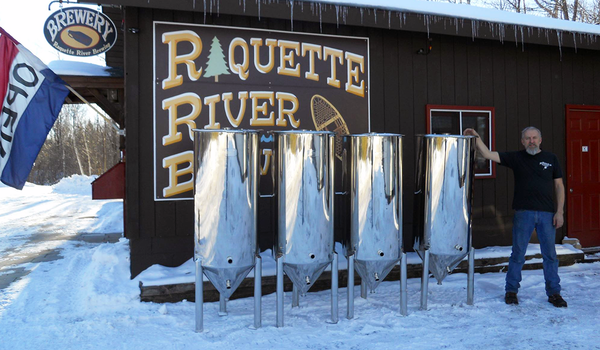 Raquette River Brewing receives a shipment of 4 new fermenters, which will allow them to double their production by summer.