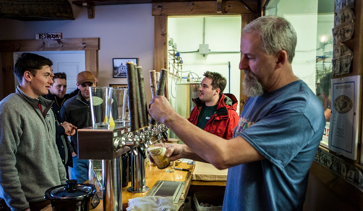 Mark serves up a fresh pint of Raquette River IPA at the brewery in Tupper Lake (ROOST / Shaun Ondak photo)