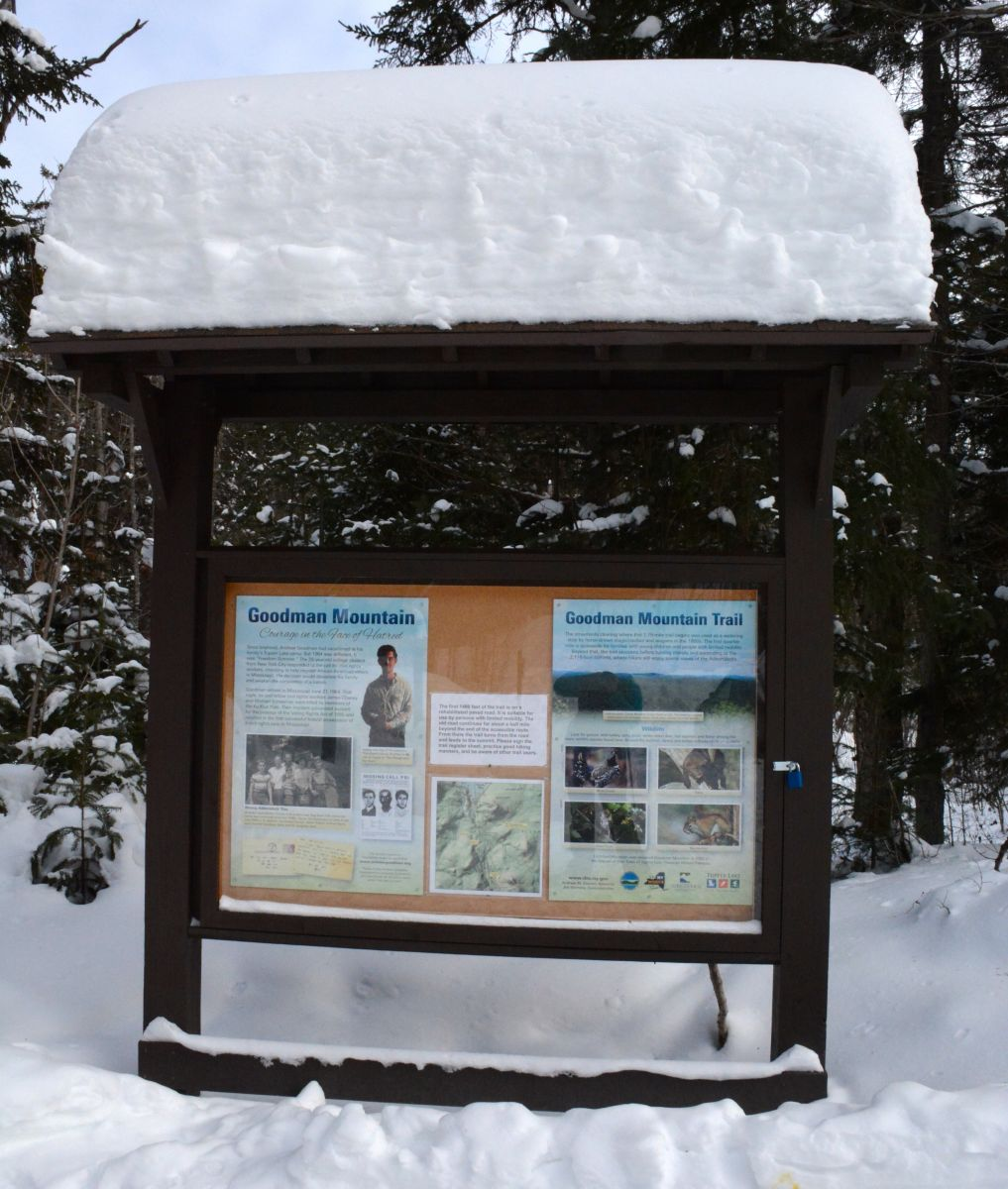 The informational display detailing the life of Mr. Andrew Goodman at the trail register of Goodman Mountain
