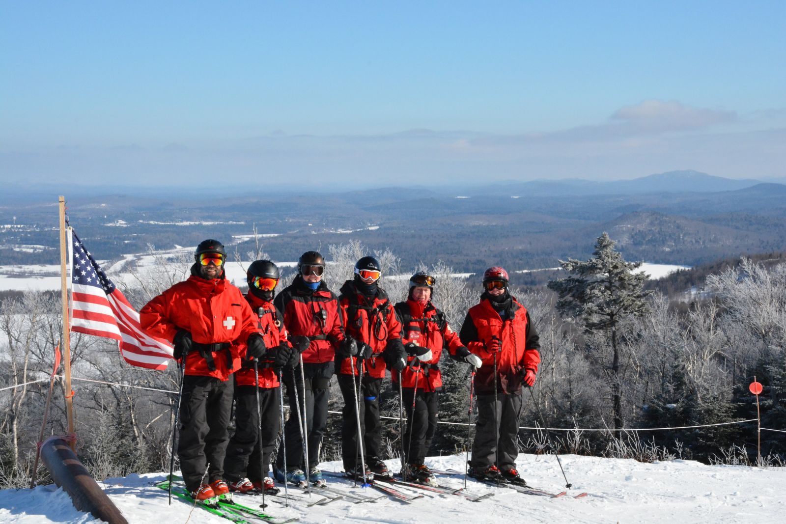 Member of the Big Tupper Ski Patrol, from left, Adam Hurteau, Mitch Harriman, Anne Maltais, Ted Merrihew, Charlie Hoffer, and Phil Jones, take a break at the top of Chair 2 for a group shot
