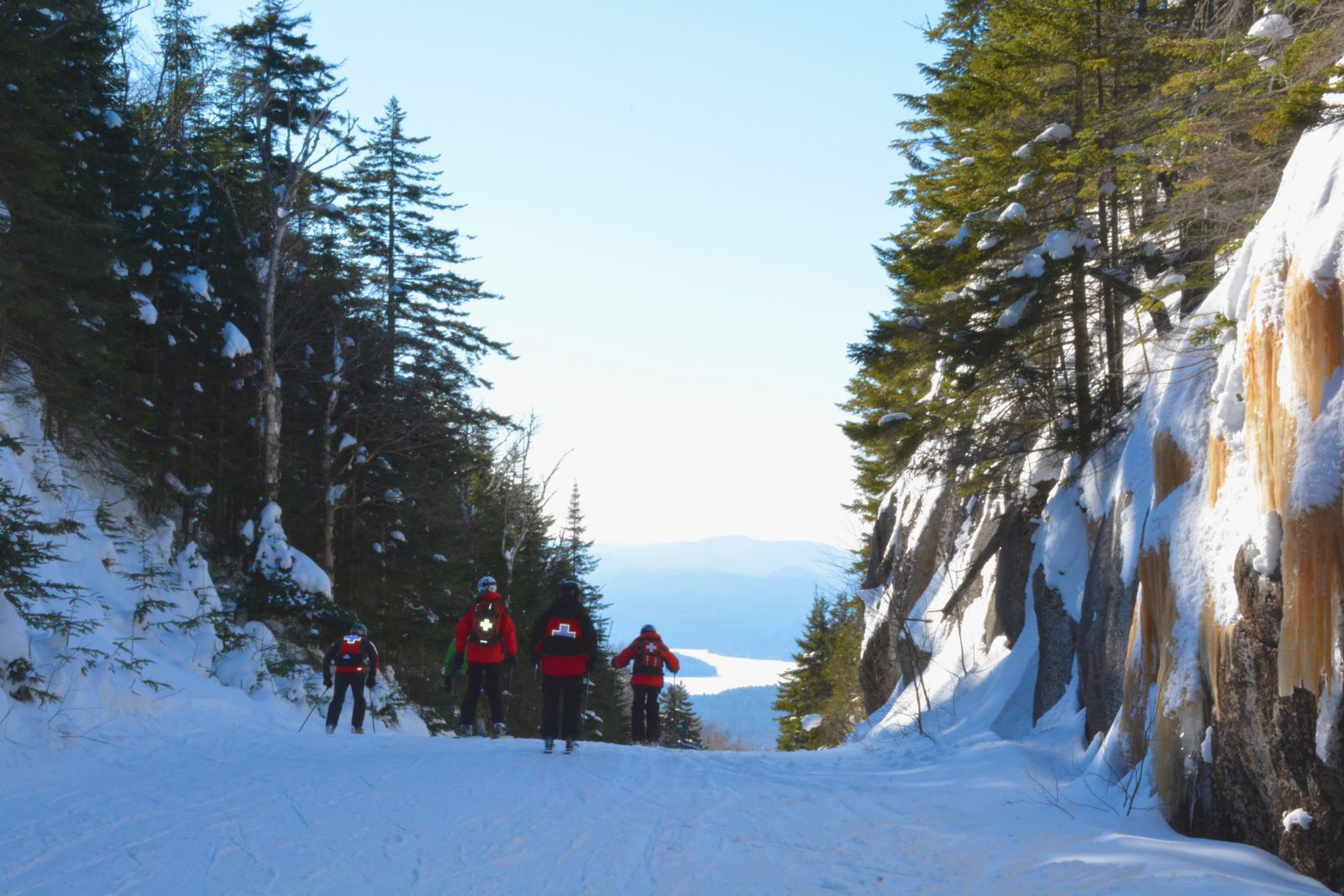 A team of patrollers heads down Palisades at the end of the day to sweep the trails of Chair 3.