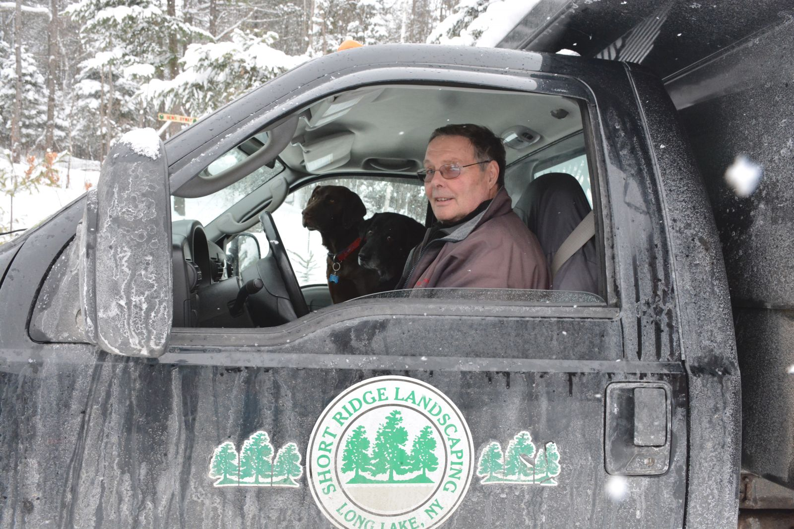 The plowing crew – Gilly, left, alongside his buddy, Misty, and my dad at the helm.