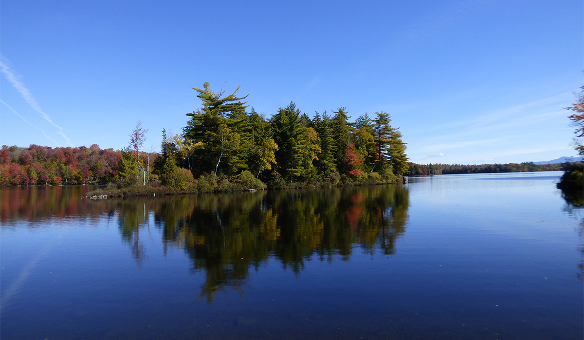 The autumn colors on Spider Island reflect off the glass like water of Piercefield Flow.