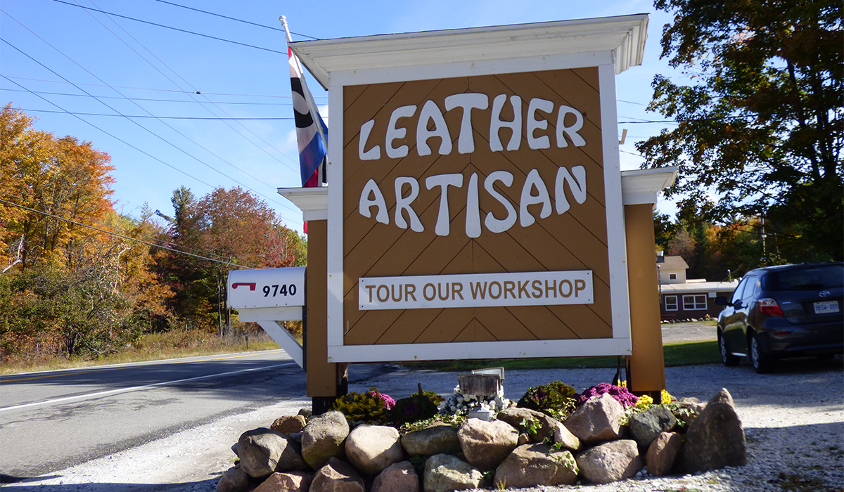 The sign at The Leather Artisan in Childwold, NY invites travelers to stop in and tour their workshop.