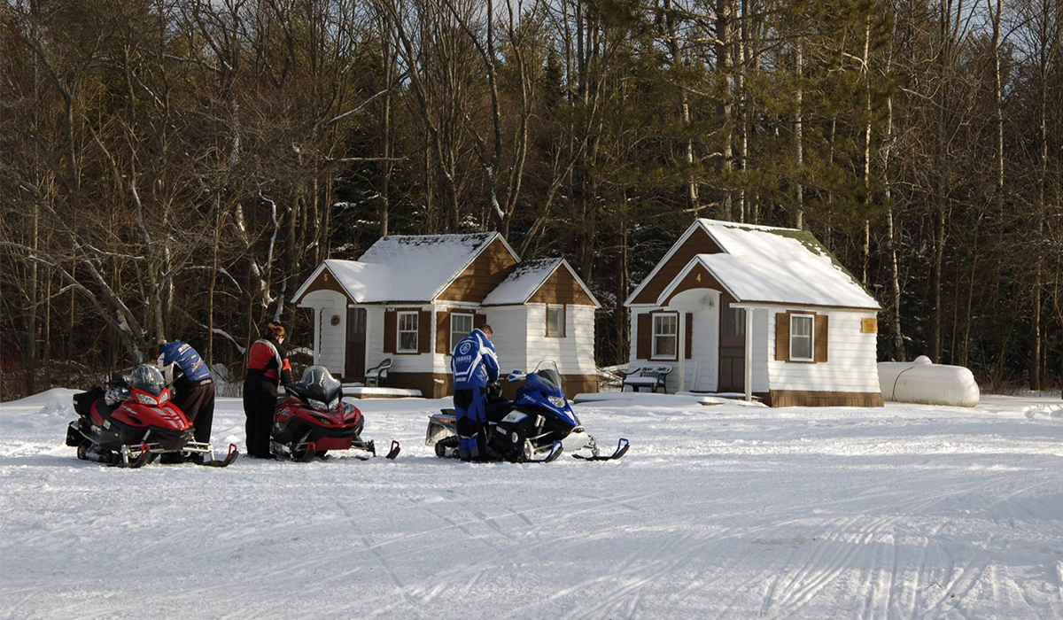Riders at the Thirsty Moose load their gear onto their sleds in anticipation of another great day of riding (Thirsty Moose photo)