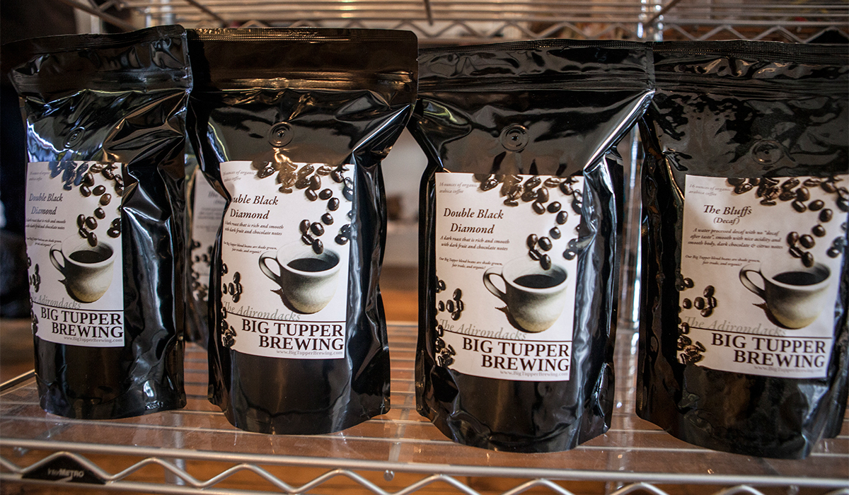 Big Tupper Brewing's Double Black Diamond whole bean coffee on the shelf at Well Dressed Food in Tupper Lake (ROOST/Shaun Ondak photo)