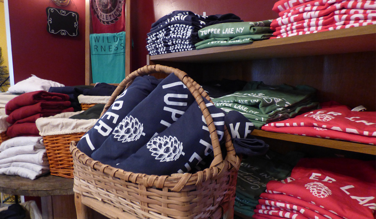 A portion of the Stacked Graphics apparel that will be available at Spruce & Hemlock Country Store