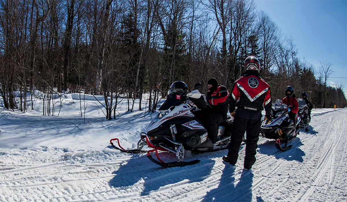 Trailside mapping - Riders take a moment to map out their route to the next cool snowmobile destination in the Tupper Lake region.