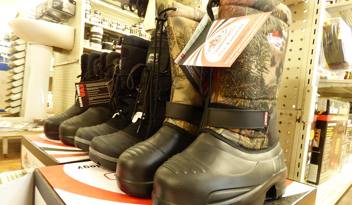 Finding the perfect fitting ice fishing boot at Fortune's True Value on Main Street in Tupper Lake.