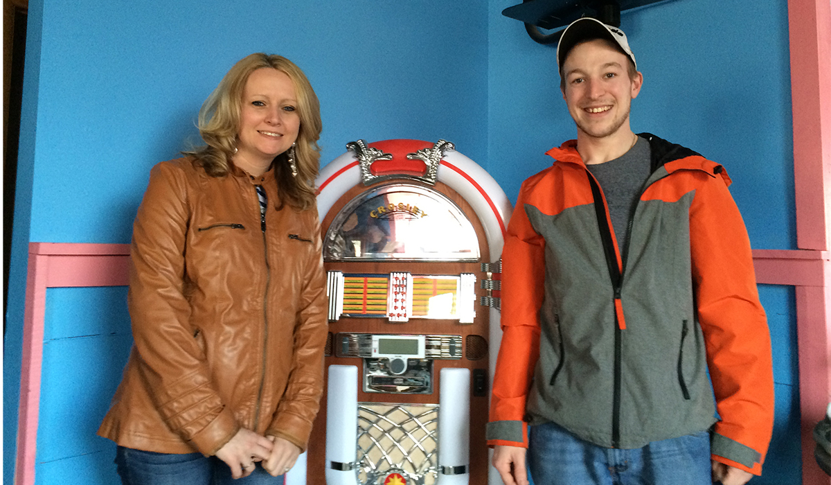 """Amanda & Mike Kelly pose next to the 50's style jukebox at """"under construction"""" Ohana's 50's Diner"""