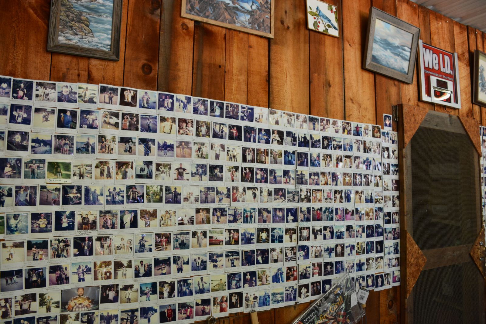 One of a few walls decorated with Polaroid photos of Blue Jay Campsite campers and friends and family of the Scottis with their proud catches of the day.