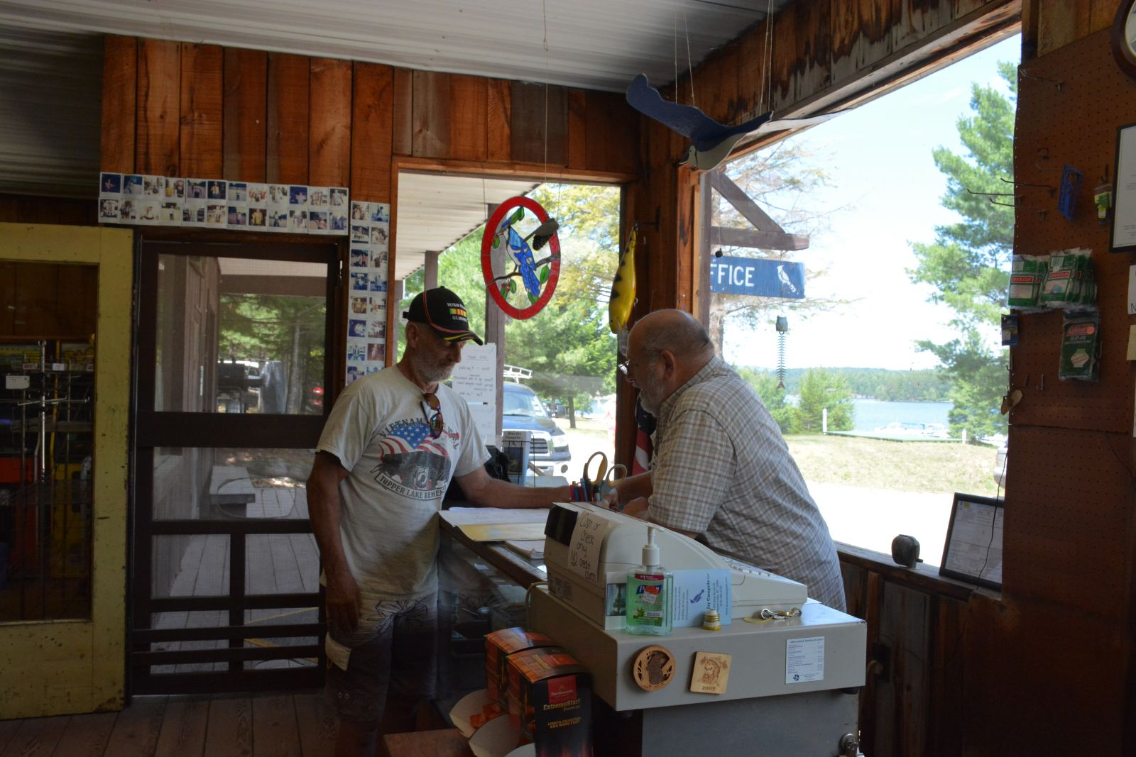 Frank Scotti points out a point of interest to a local visitor in the Blue Jay Campsite office.
