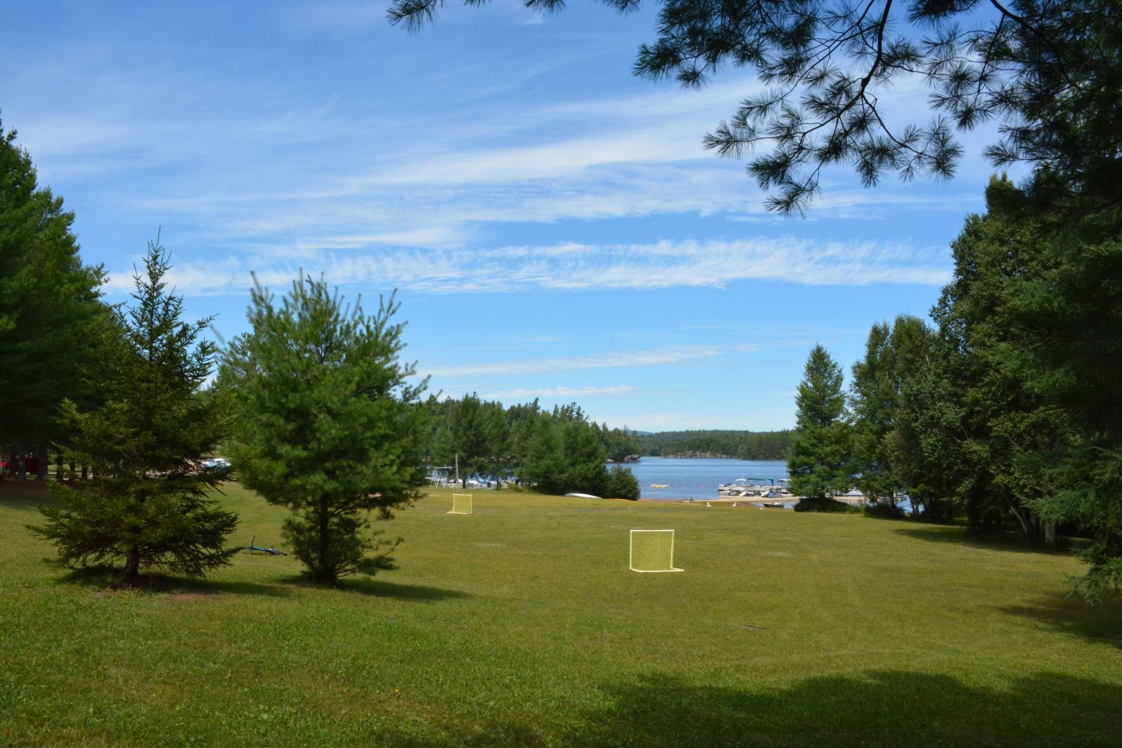 The Blue Jay Campsite property includes a beautiful stretch of lawn that leads down to the sandy beach.