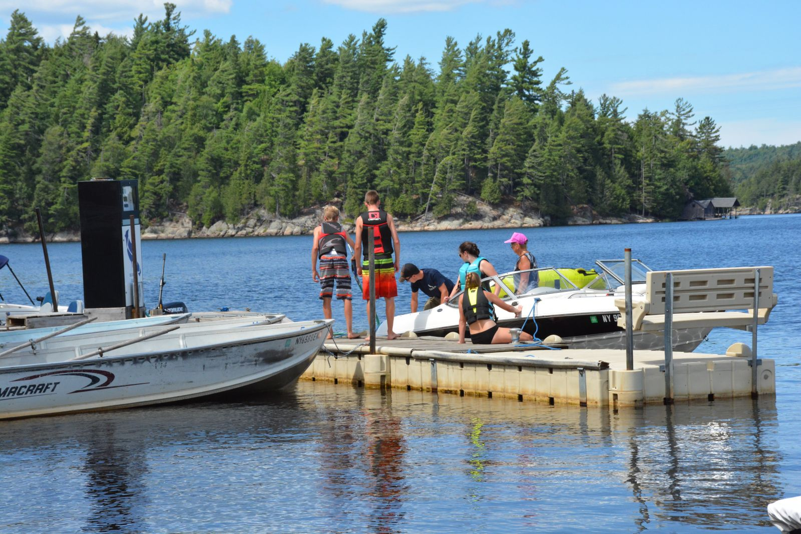 Mitch Harriman helps a few boating customers at the Blue Jay Campsite Marina.