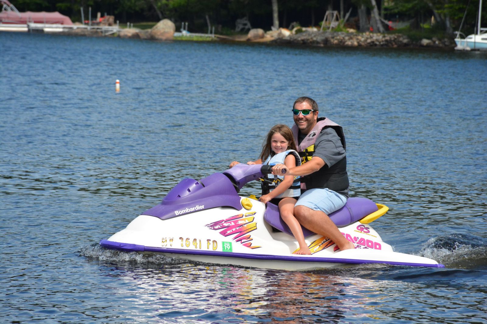 Jerry Scotti, the eldest of Frank and Sue Scotti's children, and his daughter Lucia, take off for a quick spin on the lake.