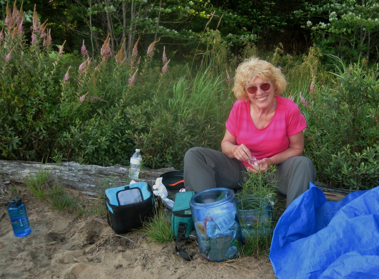 Peggy organizes the bear canisters!