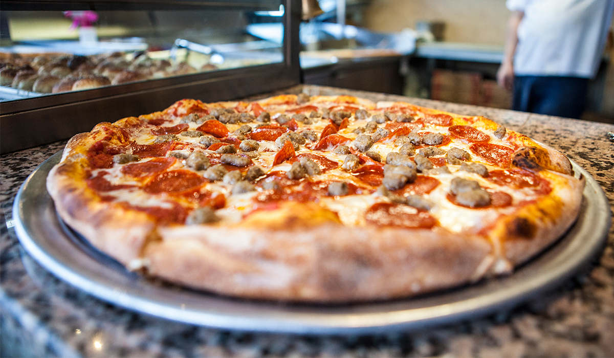 Little Italy Pizza - Watch the game at the bar or order take-out and watch it back at the room.