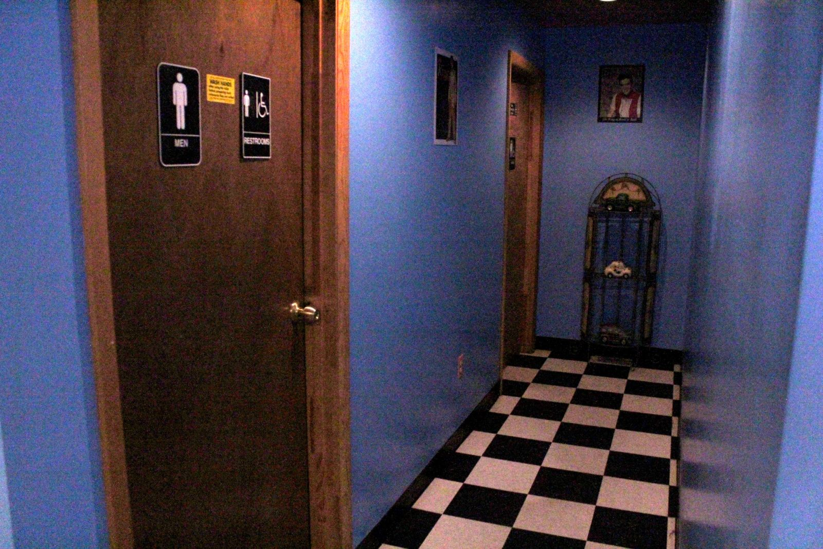 Two young men in 1920's attire have been seen in this hallway.