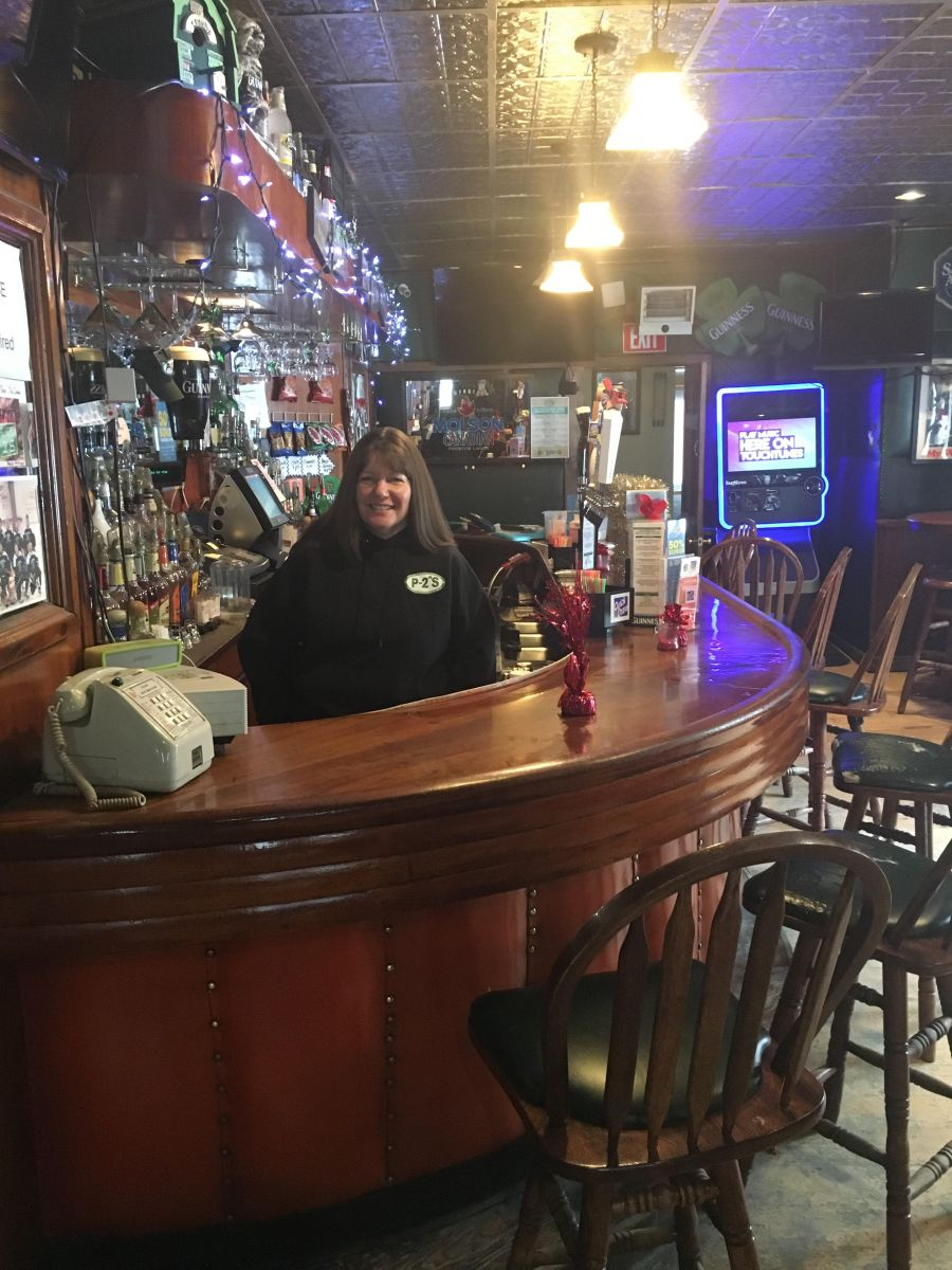 P-2's daughter Michelle, behind the bar.
