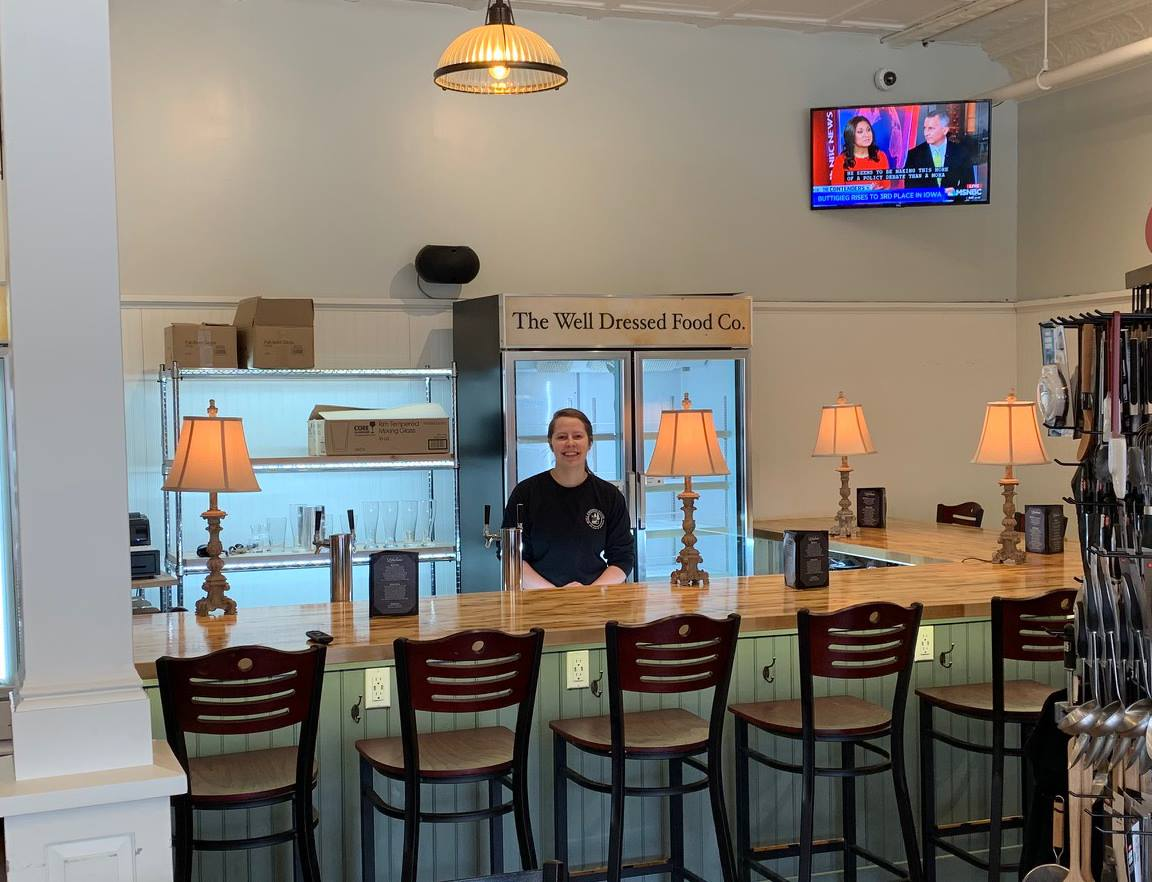 Mary behind the new bar at Well Dressed Food