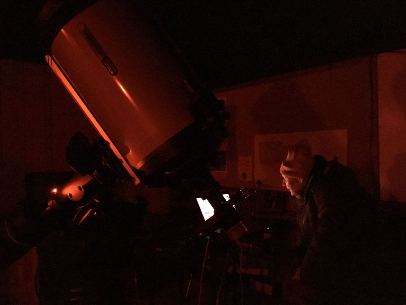 "George Normandin controls a 14"" Celestron with a laptop in red light conditions."
