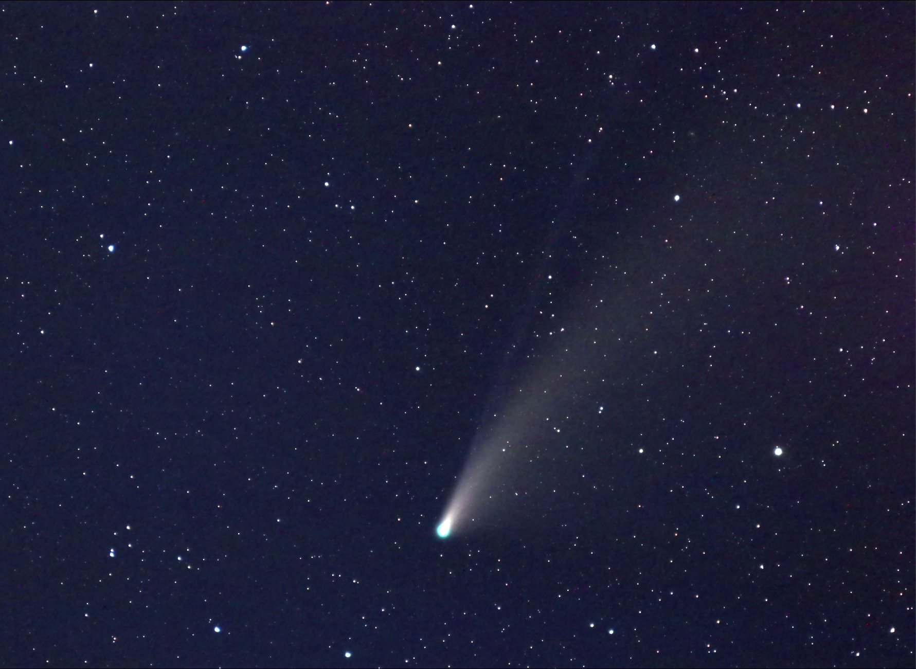 Comet NEOWISE against a backdrop of stars. Photo courtesy astrophotographer George Normandin.