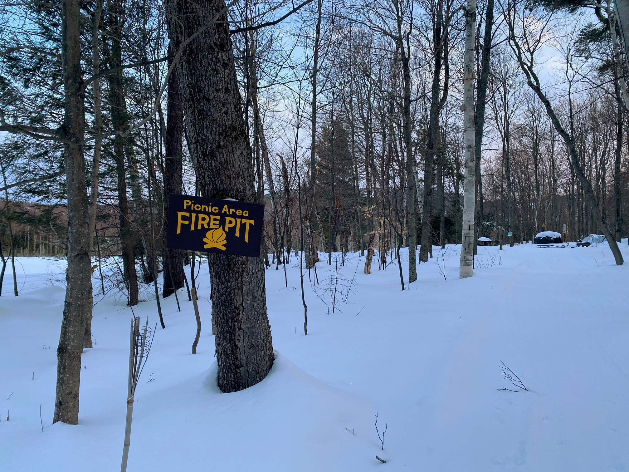 Sign for the fire pit where you can take a break and take in the views.