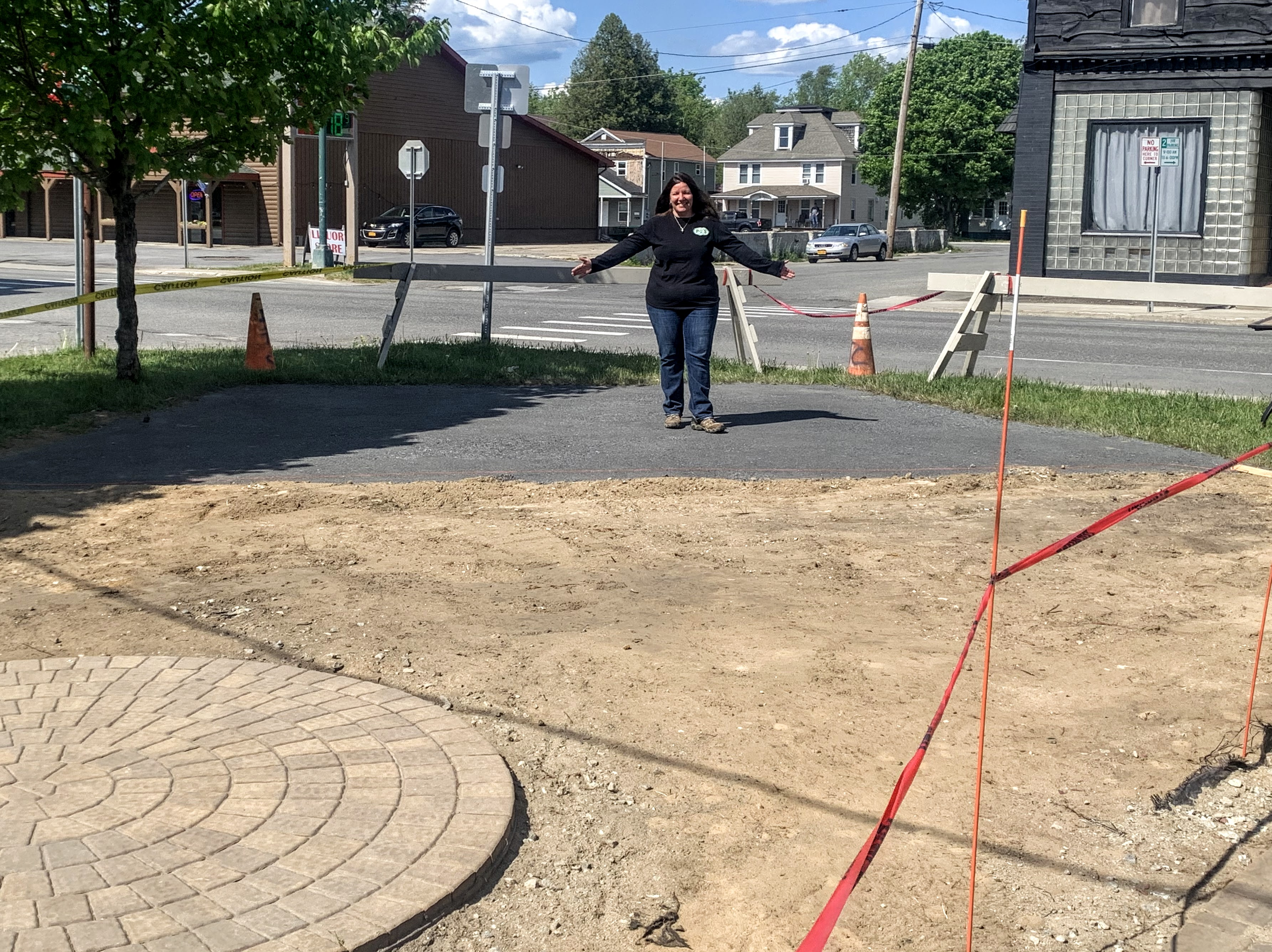 Michelle LeBlanc Blair stands at the construction site of the new band shell at P-2's