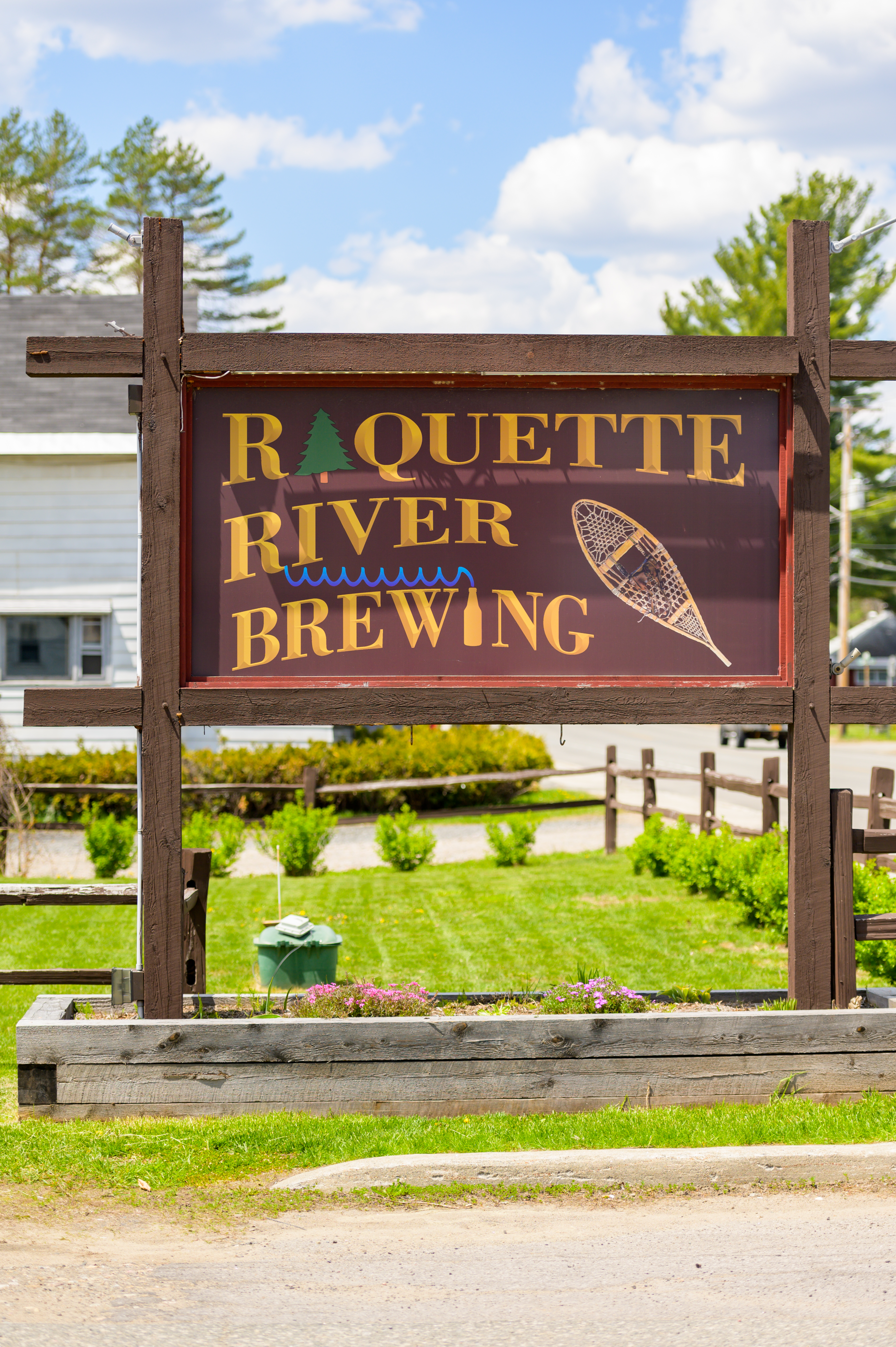 The entrance sign for Raquette River Brewing