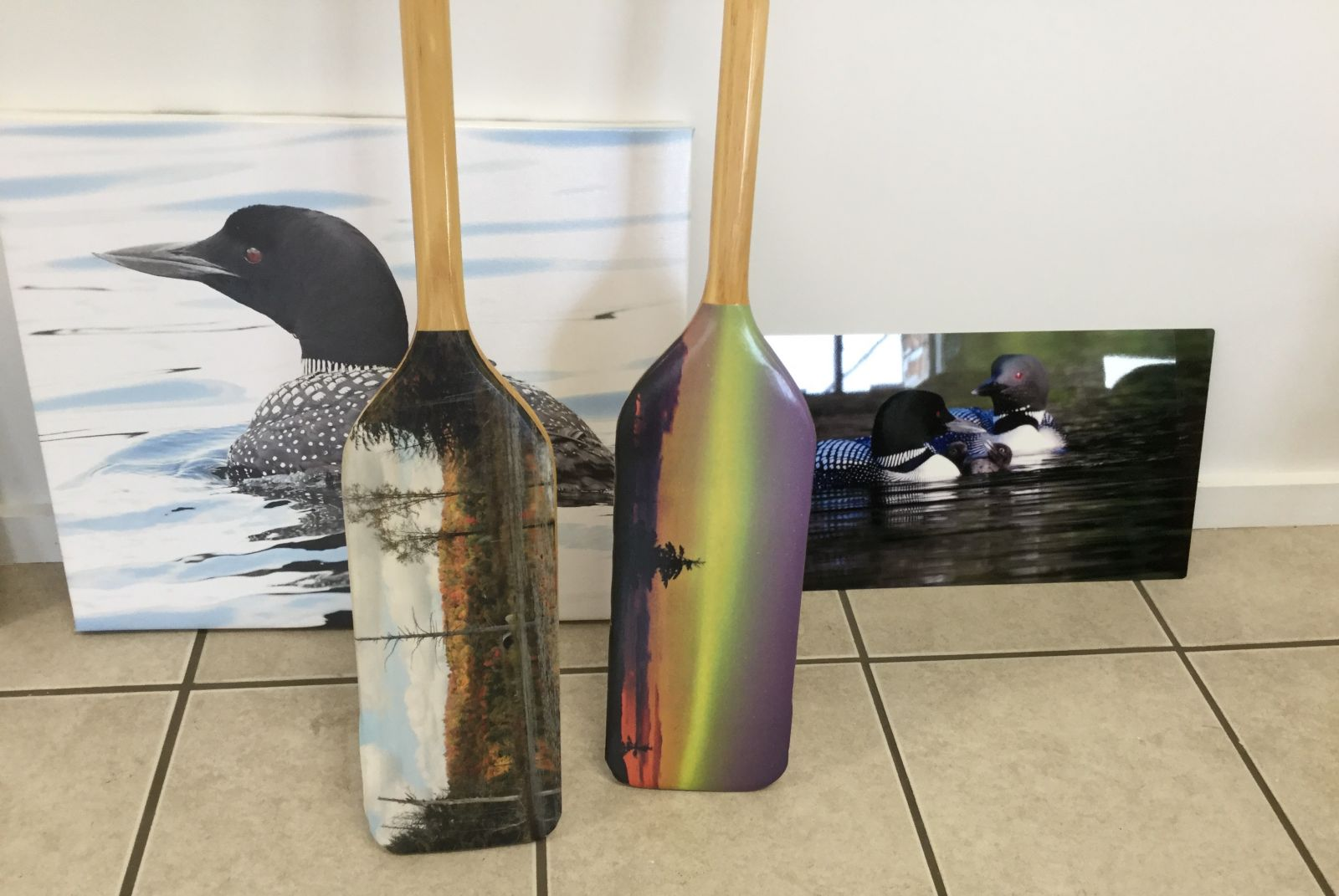 This art is full of Adirondack nature, even down to the painted canoe paddles.