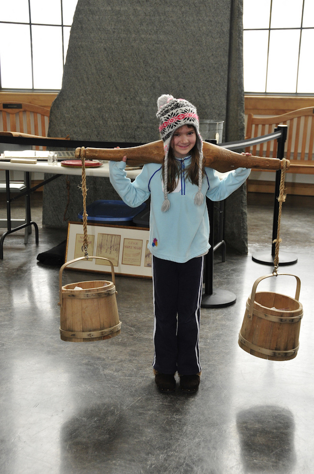 Historically authentic pails and yokes help children understand how we get maple syrup to our flapjacks.
