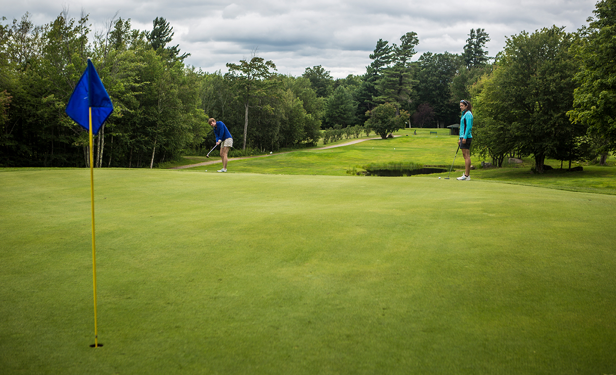Putting on Tupper Lake's terrific greens.