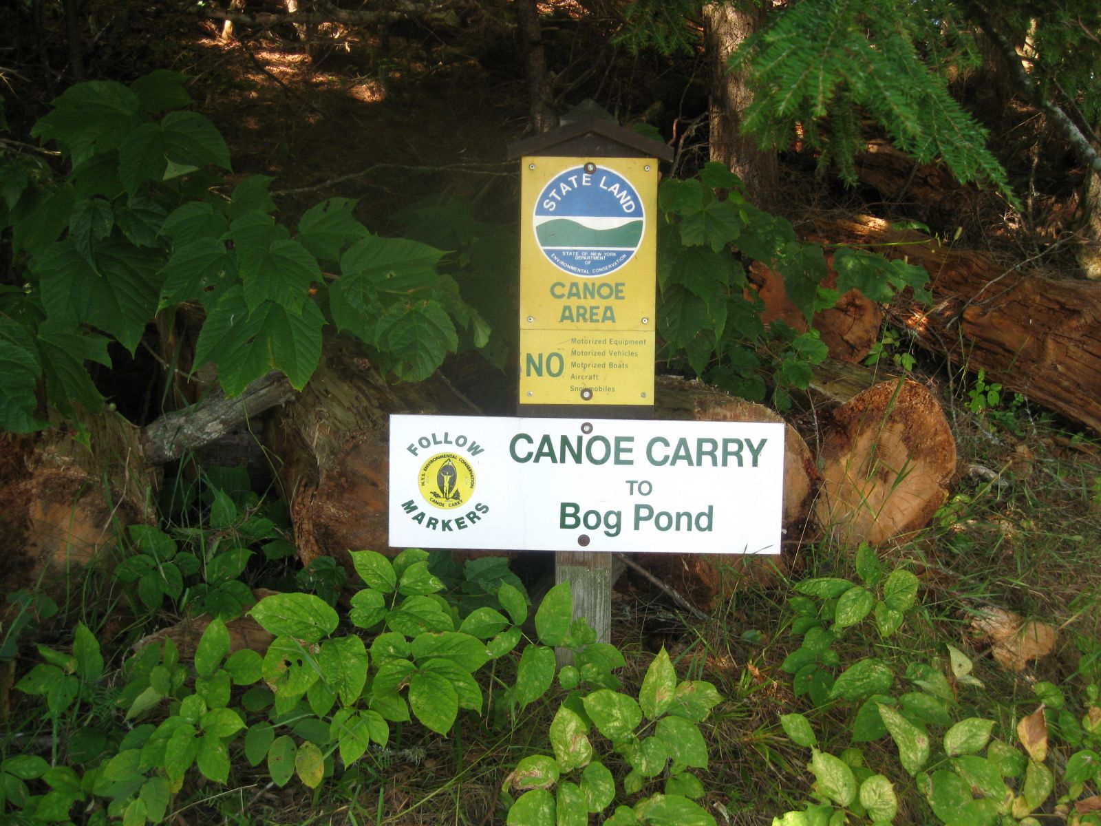 The portage sign for Bog Pond.